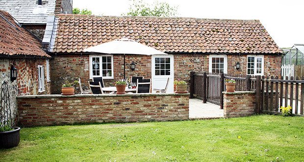 Rear patio at Mr Bumble's Barn Holiday Cottage.